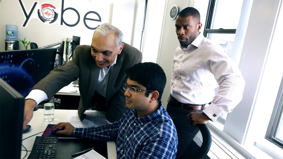 Dr. Nawab and Ken Sutton consult with a software developer at Yobe headquarters in Boston.