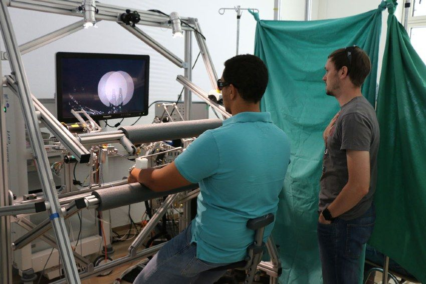Figure 5. Johannes Bilz and colleague conducting a task performance test to evaluate haptic feedback and 3D endoscope vision at University Hospital Tübingen.